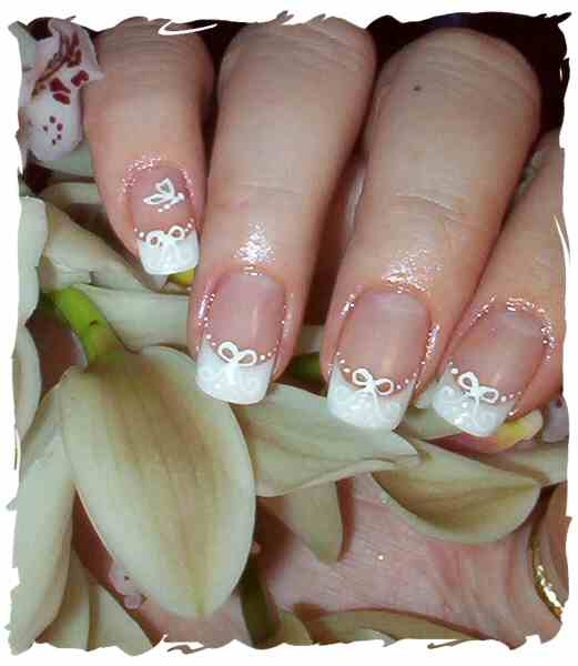 wedding nail art bows and butterfly white nail polish wedding nails wedding manicure nail art manicure of bride manicure for wedding French manicure
